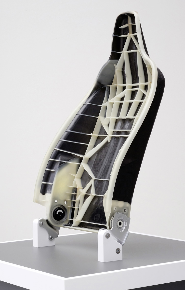 Multi-material systems in vehicle seat